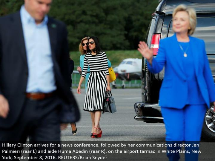 Hillary Clinton touches base for a news gathering, trailed by her interchanges executive Jen Palmieri (raise L) and helper Huma Abedin (raise R), on the air terminal landing area in White Plains, New York, September 8, 2016. REUTERS/Brian Snyder