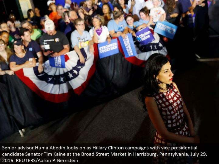 Senior consultant Huma Abedin looks on as Hillary Clinton crusades with bad habit presidential competitor Senator Tim Kaine at the Broad Street Market in Harrisburg, Pennsylvania, July 29, 2016. REUTERS/Aaron P. Bernstein