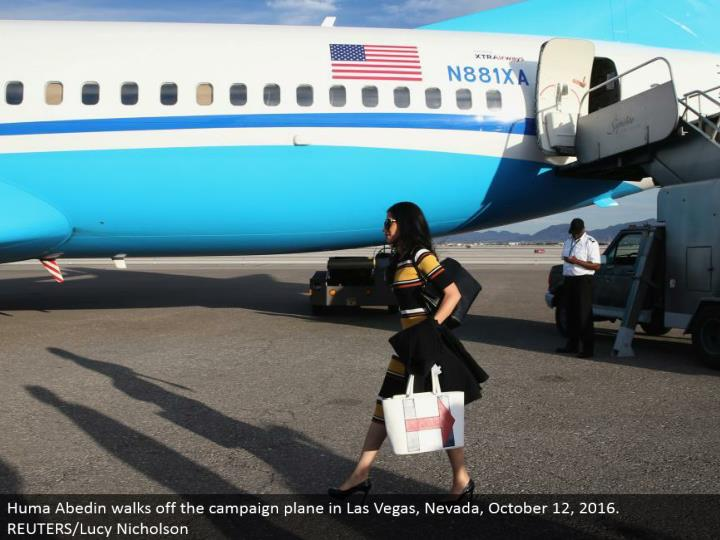 Huma Abedin strolls off the battle plane in Las Vegas, Nevada, October 12, 2016. REUTERS/Lucy Nicholson