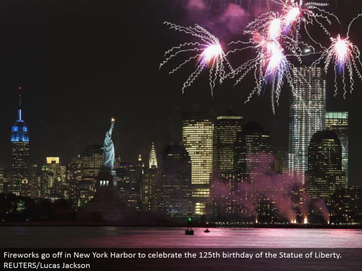 Fireworks go off in New York Harbor to commend the 125th birthday of the Statue of Liberty. REUTERS/Lucas Jackson