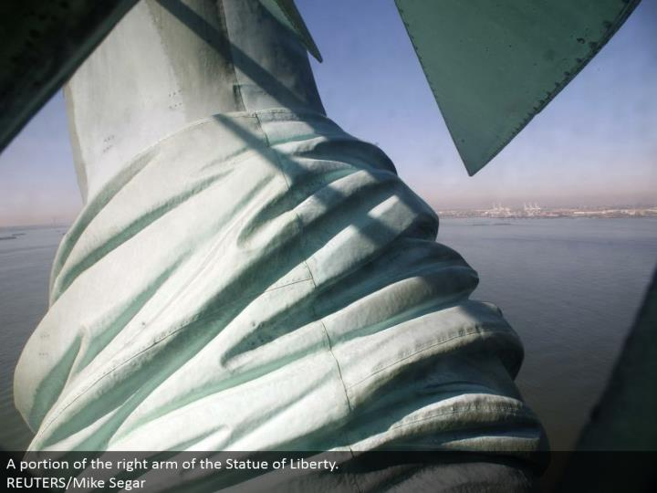 A part of the right arm of the Statue of Liberty.  REUTERS/Mike Segar