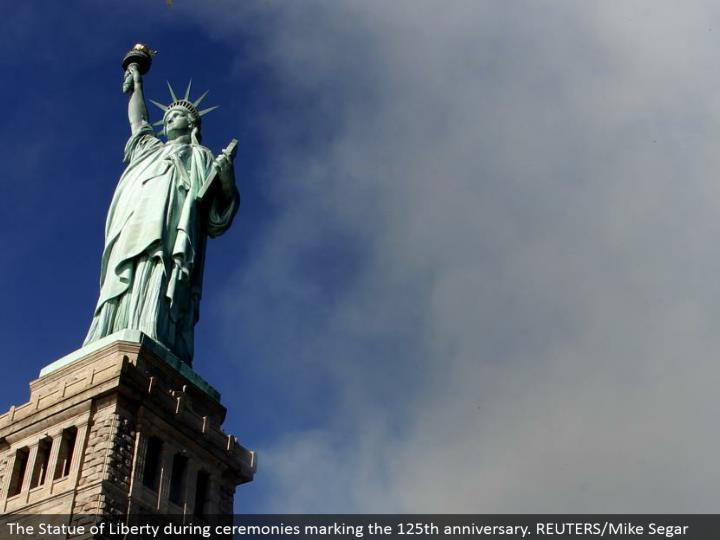 The Statue of Liberty amid services denoting the 125th commemoration. REUTERS/Mike Segar