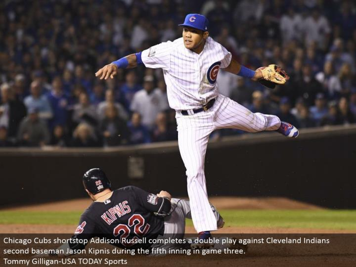 Chicago Cubs shortstop Addison Russell finishes a twofold play against Cleveland Indians second baseman Jason Kipnis amid the fifth inning in diversion three.  Tommy Gilligan-USA TODAY Sports