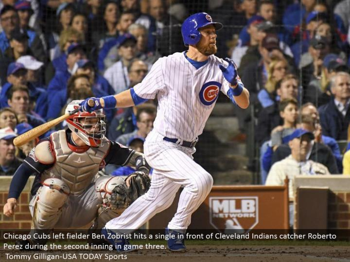 Chicago Cubs left defender Ben Zobrist hits a solitary before Cleveland Indians catcher Roberto Perez amid the second inning in diversion three.  Tommy Gilligan-USA TODAY Sports