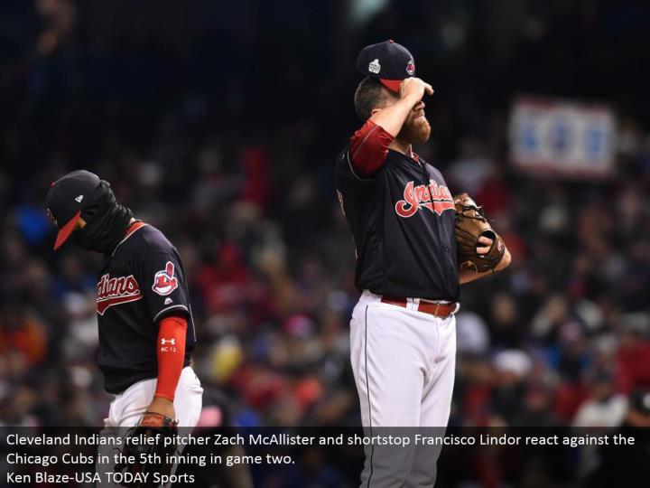 Cleveland Indians help pitcher Zach McAllister and shortstop Francisco Lindor respond against the Chicago Cubs in the fifth inning in amusement two.  Ken Blaze-USA TODAY Sports