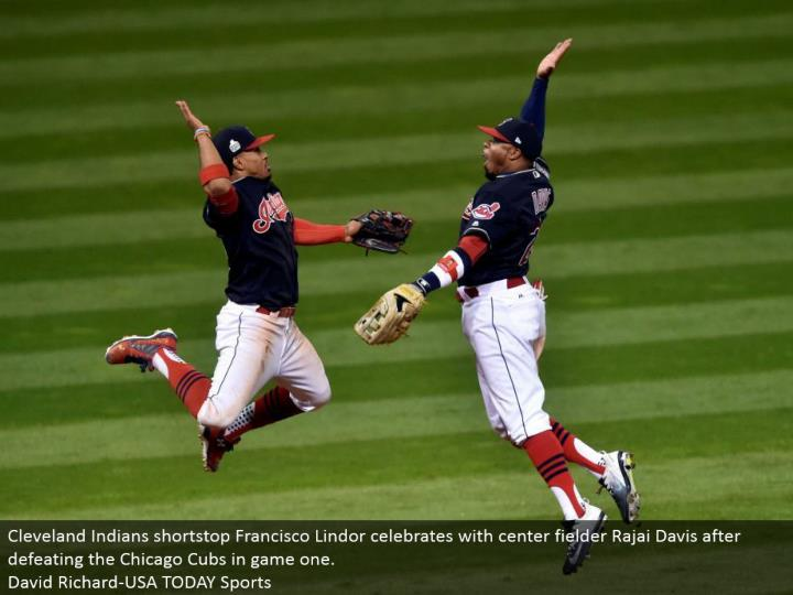 Cleveland Indians shortstop Francisco Lindor celebrates with focus defender Rajai Davis subsequent to vanquishing the Chicago Cubs in amusement one.  David Richard-USA TODAY Sports