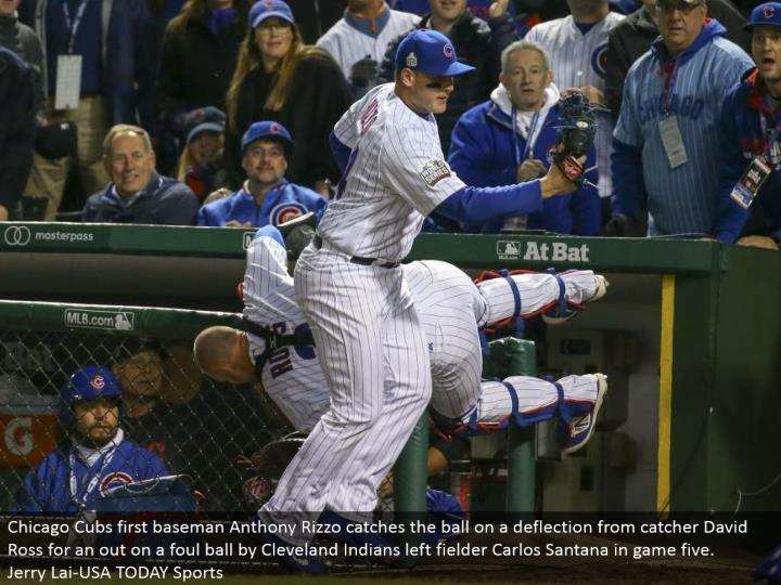 Chicago Cubs first baseman Anthony Rizzo gets the ball on an avoidance from catcher David Ross for a...