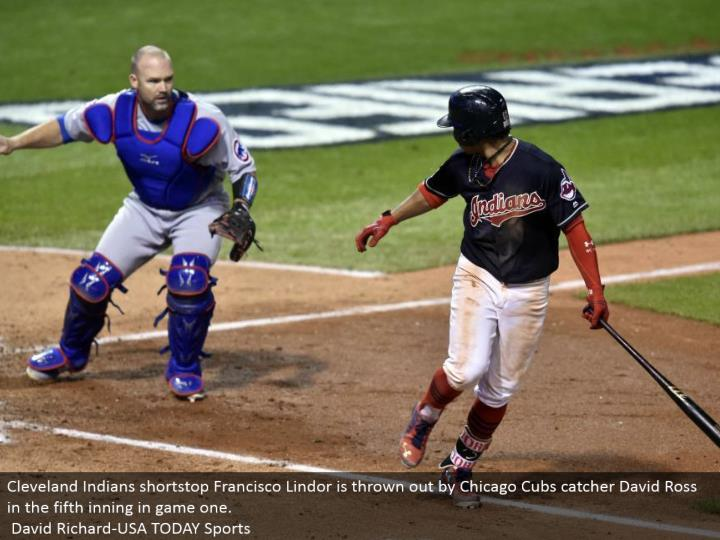 Cleveland Indians shortstop Francisco Lindor is tossed out by Chicago Cubs catcher David Ross in the fifth inning in amusement one. David Richard-USA TODAY Sports