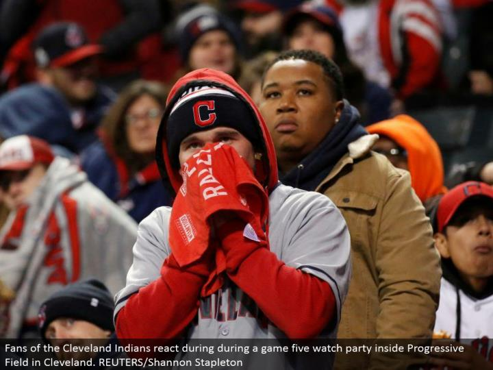 Fans of the Cleveland Indians respond amid a diversion five watch party inside Progressive Field in ...
