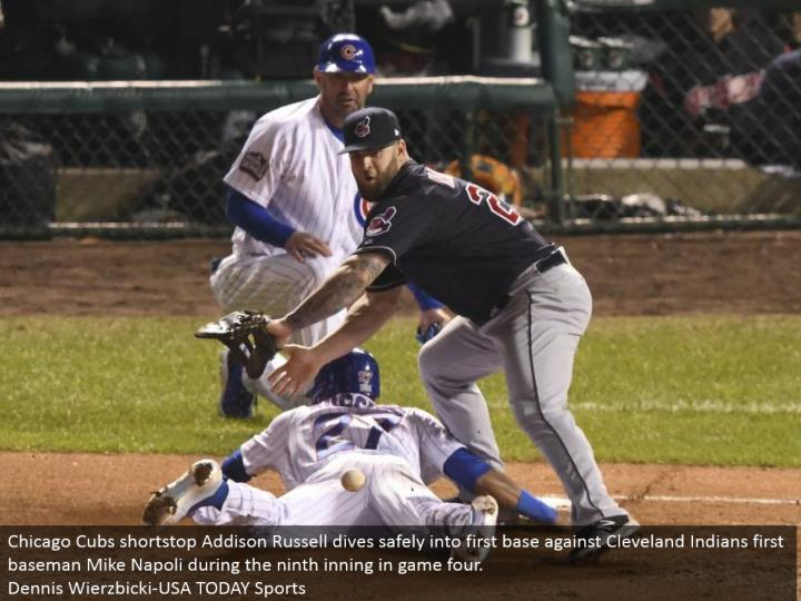 Chicago Cubs shortstop Addison Russell plunges securely into a respectable starting point against Cleveland Indians first baseman Mike Napoli amid the ninth inning in amusement four.  Dennis Wierzbicki-USA TODAY Sports