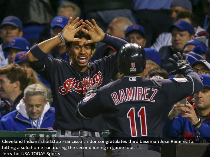 Cleveland Indians shortstop Francisco Lindor praises third baseman Jose Ramirez for hitting a performance grand slam amid the second inning in amusement four.  Jerry Lai-USA TODAY Sports