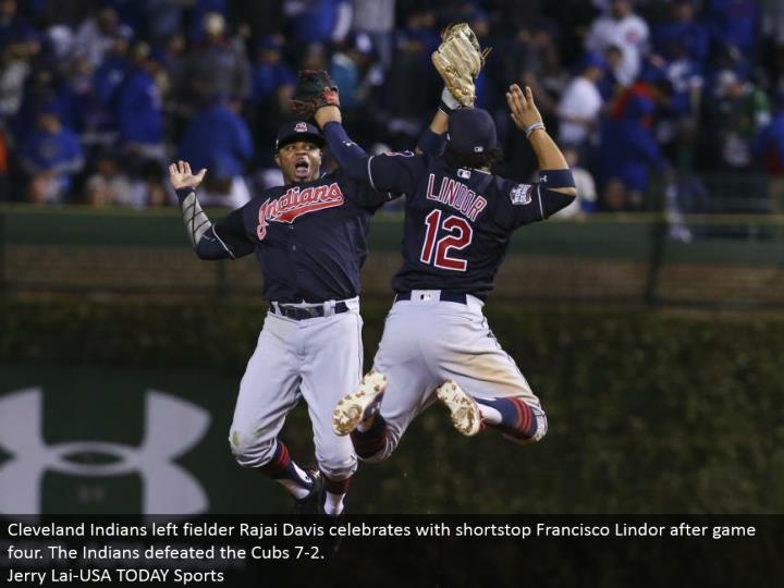 Cleveland Indians left defender Rajai Davis celebrates with shortstop Francisco Lindor after diversion four. The Indians vanquished the Cubs 7-2.  Jerry Lai-USA TODAY Sports