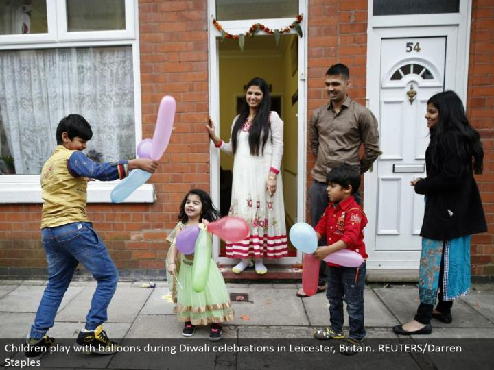 Children play with inflatables amid Diwali festivities in Leicester, Britain. REUTERS/Darren Staples