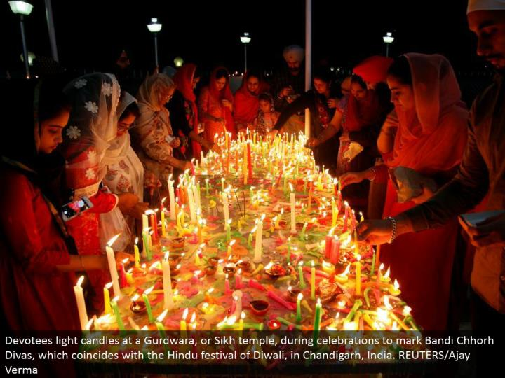 Devotees light candles at a Gurdwara, or Sikh sanctuary, amid festivities to check Bandi Chhorh Divas, which concurs with the Hindu celebration of Diwali, in Chandigarh, India. REUTERS/Ajay Verma