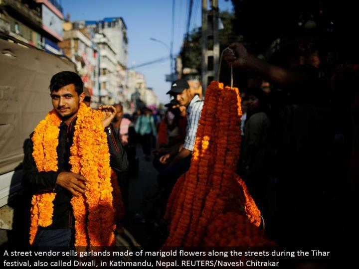 A road merchant offers wreaths made of marigold blooms along the lanes amid the Tihar celebration, additionally called Diwali, in Kathmandu, Nepal. REUTERS/Navesh Chitrakar