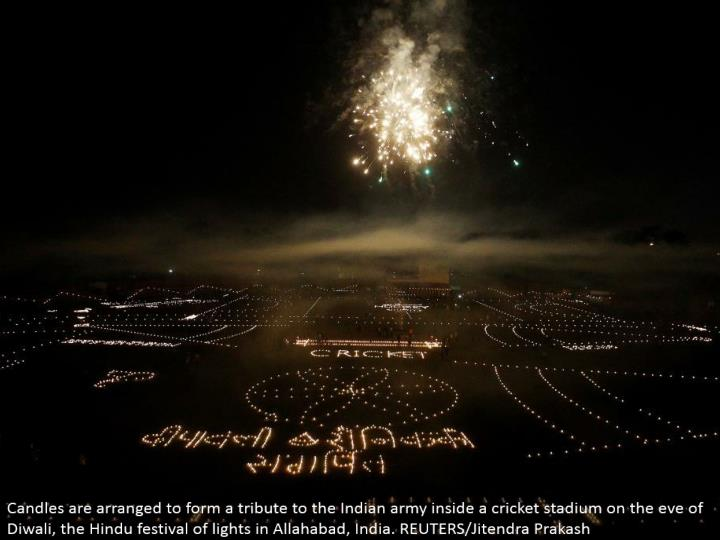 Candles are organized to shape a tribute to the Indian armed force inside a cricket stadium on the eve of Diwali, the Hindu celebration of lights in Allahabad, India. REUTERS/Jitendra Prakash