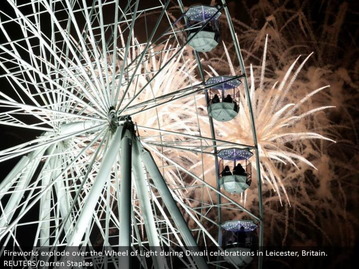 Fireworks detonate over the Wheel of Light amid Diwali festivities in Leicester, Britain. REUTERS/Darren Staples