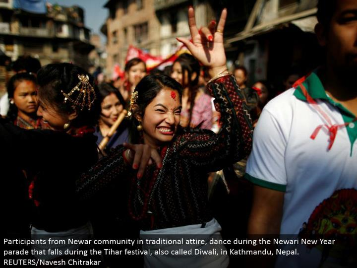 Participants from Newar people group in customary clothing, move amid the Newari New Year parade that falls amid the Tihar celebration, likewise called Diwali, in Kathmandu, Nepal. REUTERS/Navesh Chitrakar