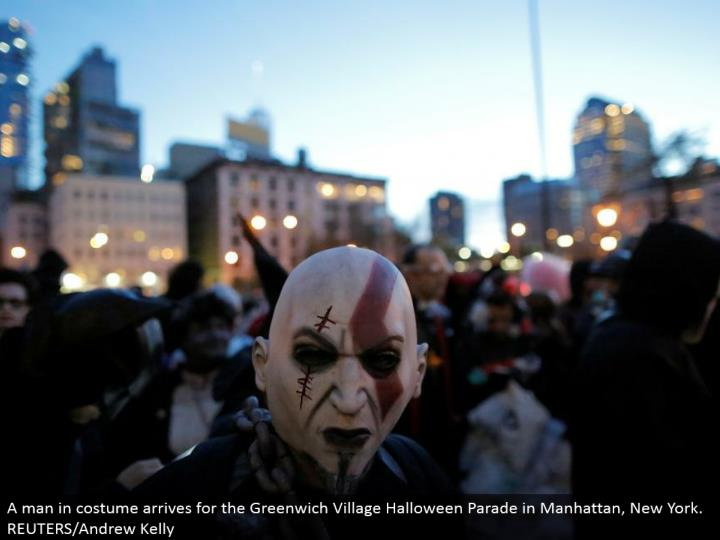 A man in outfit lands for the Greenwich Village Halloween Parade in Manhattan, New York. REUTERS/Andrew Kelly