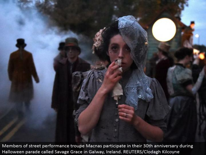 Members of road execution troupe Macnas take part in their 30th commemoration amid Halloween parade called Savage Grace in Galway, Ireland. REUTERS/Clodagh Kilcoyne