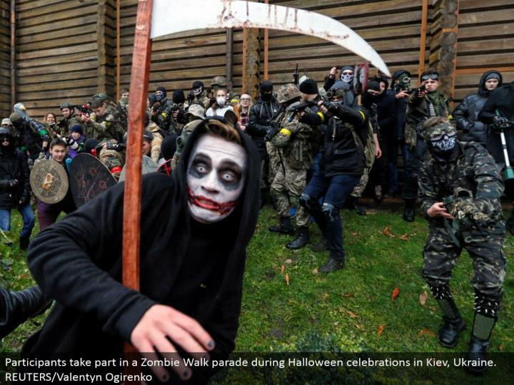 Participants partake in a Zombie Walk parade amid Halloween festivities in Kiev, Ukraine. REUTERS/Valentyn Ogirenko