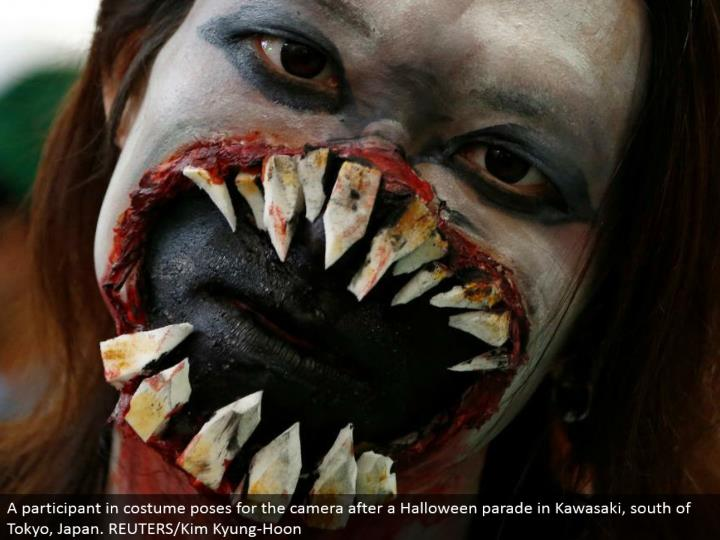 A member in ensemble postures for the camera after a Halloween parade in Kawasaki, south of Tokyo, Japan. REUTERS/Kim Kyung-Hoon