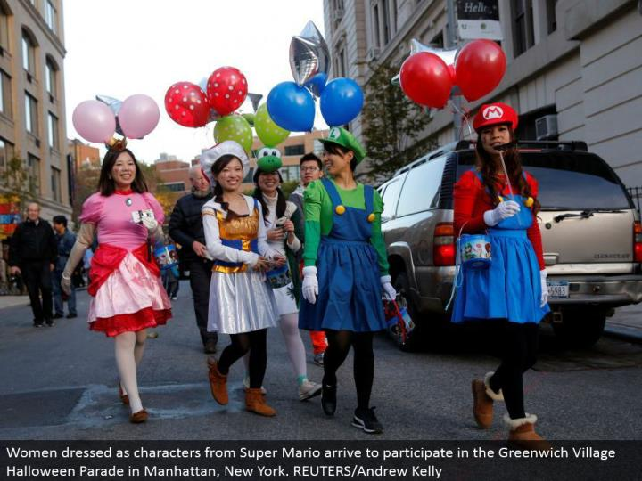 Women dressed as characters from Super Mario touch base to partake in the Greenwich Village Halloween Parade in Manhattan, New York. REUTERS/Andrew Kelly