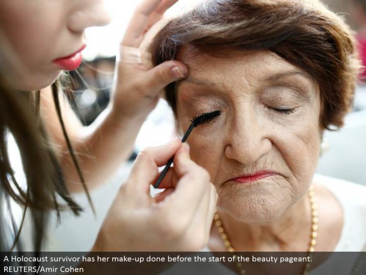 A Holocaust survivor has her make-up done before the begin of the magnificence expo. REUTERS/Amir Co...