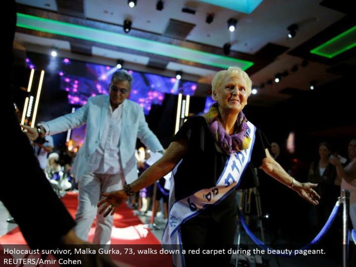 Holocaust survivor, Malka Gurka, 73, strolls down a celebrity main street amid the excellence expo. REUTERS/Amir Cohen