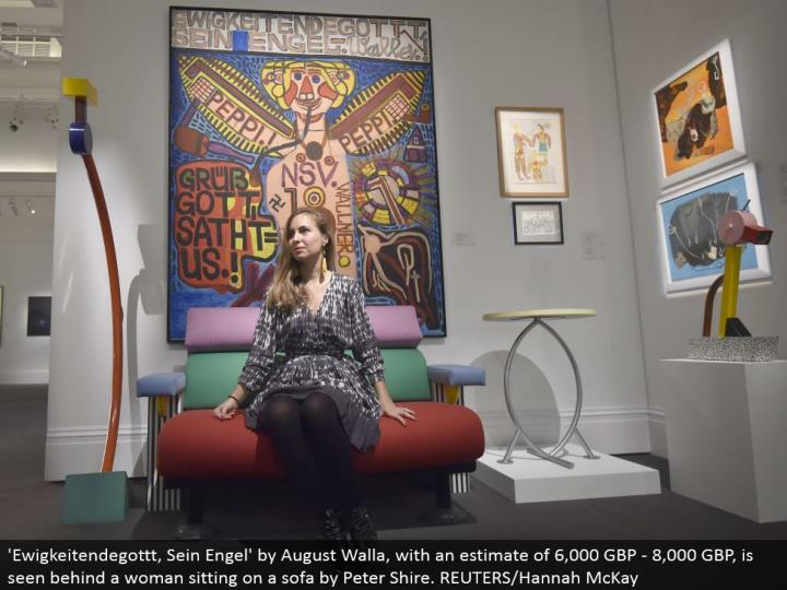 'Ewigkeitendegottt, Sein Engel' by August Walla, with a gauge of 6,000 GBP - 8,000 GBP, is seen behind a lady sitting on a couch by Peter Shire. REUTERS/Hannah McKay
