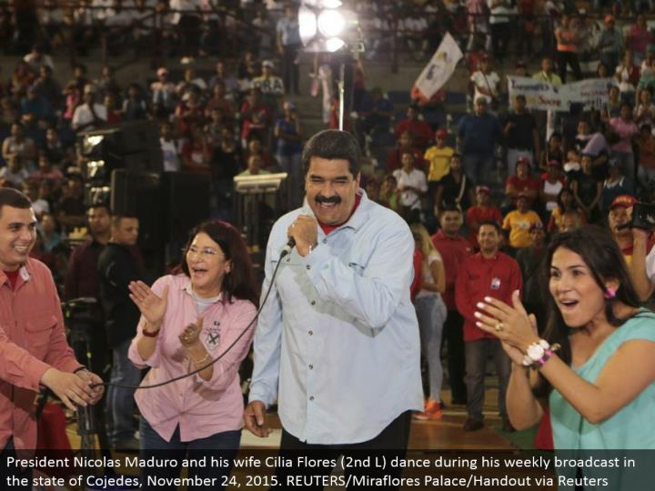 President Nicolas Maduro and his better half Cilia Flores (second L) move amid his week after week communicate in the condition of Cojedes, November 24, 2015. REUTERS/Miraflores Palace/Handout by means of Reuters