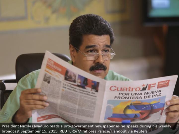 President Nicolas Maduro peruses a genius government daily paper as he talks amid his week after week communicate September 15, 2015. REUTERS/Miraflores Palace/Handout through Reuters