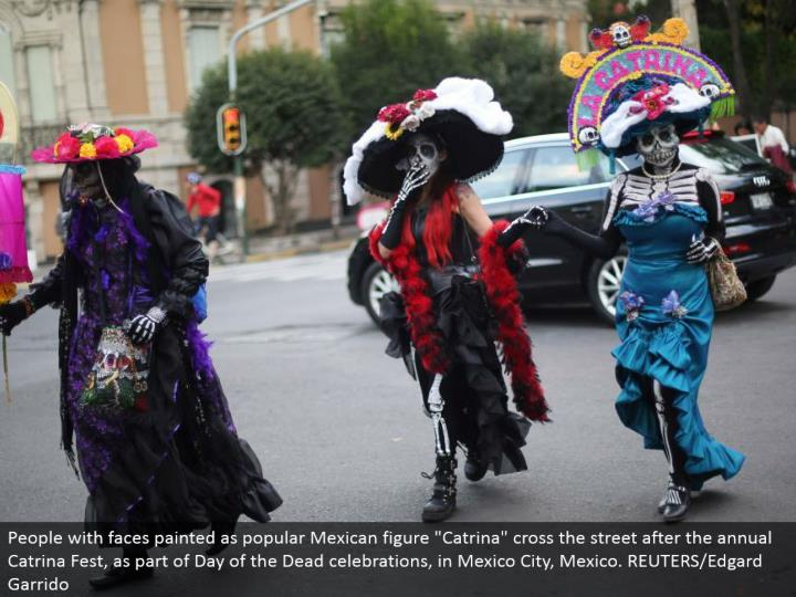 "People with appearances painted as well known Mexican figure ""Catrina"" cross the road after the yearly Catrina Fest, as a major aspect of Day of the Dead festivals, in Mexico City, Mexico. REUTERS/Edgard Garrido"