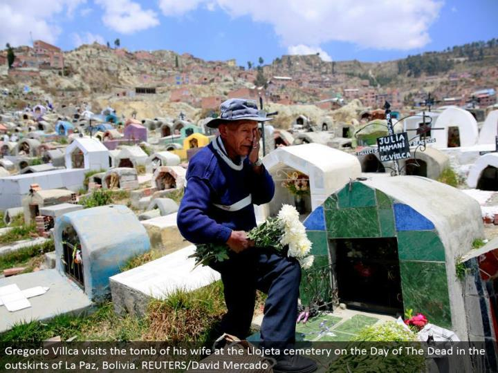 Gregorio Villca visits the tomb of his better half at the Llojeta burial ground on the Day of The Dead in the edges of La Paz, Bolivia. REUTERS/David Mercado