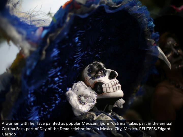 "A lady with her face painted as well known Mexican figure ""Catrina"" partakes in the yearly Catrina Fest, some portion of Day of the Dead festivals, in Mexico City, Mexico. REUTERS/Edgard Garrido"