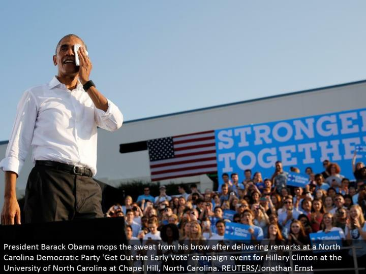 President Barack Obama mops the sweat from his temples subsequent to conveying comments at a North Carolina Democratic Party 'Get Out the Early Vote' crusade occasion for Hillary Clinton at the University of North Carolina at Chapel Hill, North Carolina. REUTERS/Jonathan Ernst