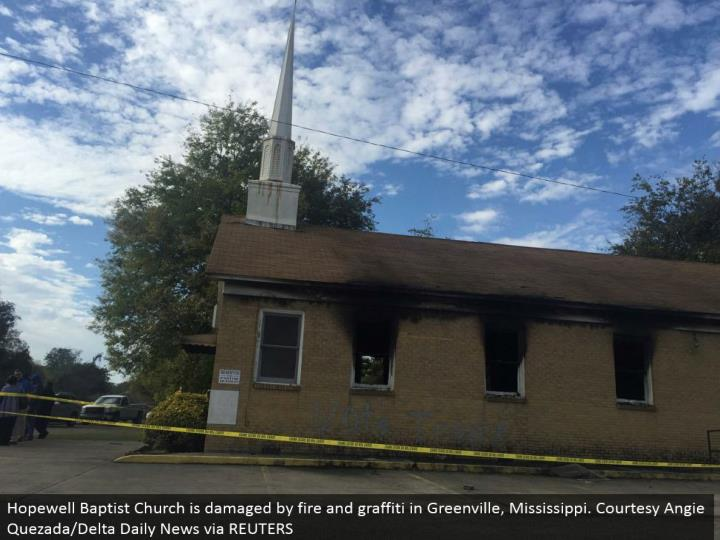 Hopewell Baptist Church is harmed by flame and graffiti in Greenville, Mississippi. Civility Angie Quezada/Delta Daily News by means of REUTERS