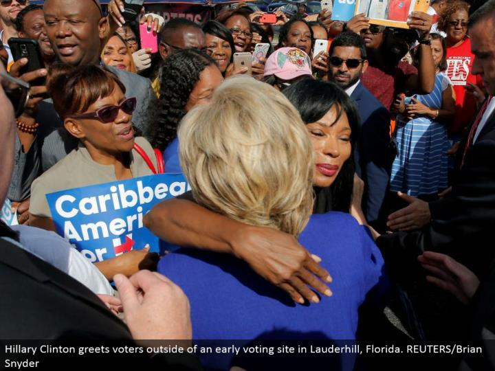 Hillary Clinton welcomes voters outside of an early voting site in Lauderhill, Florida. REUTERS/Brian Snyder