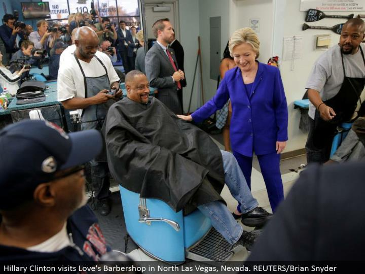 Hillary Clinton visits Love's Barbershop in North Las Vegas, Nevada. REUTERS/Brian Snyder
