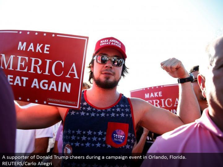 A supporter of Donald Trump cheers amid a battle occasion in Orlando, Florida. REUTERS/Carlo Allegri
