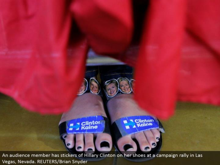 An group of onlookers part has stickers of Hillary Clinton on her shoes at a battle rally in Las Vegas, Nevada. REUTERS/Brian Snyder
