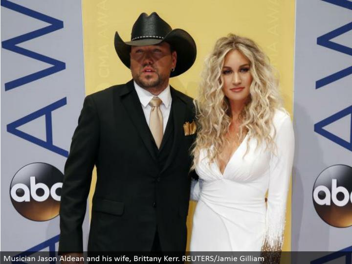 Musician Jason Aldean and his significant other, Brittany Kerr. REUTERS/Jamie Gilliam