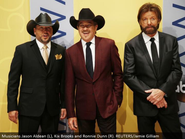Musicians Jason Aldean (L), Kix Brooks and Ronnie Dunn (R). REUTERS/Jamie Gilliam
