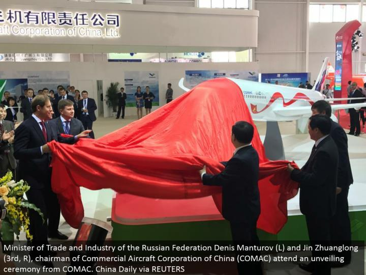 Minister of Trade and Industry of the Russian Federation Denis Manturov (L) and Jin Zhuanglong (third, R), administrator of Commercial Aircraft Corporation of China (COMAC) go to an uncovering service from COMAC. China Daily by means of REUTERS