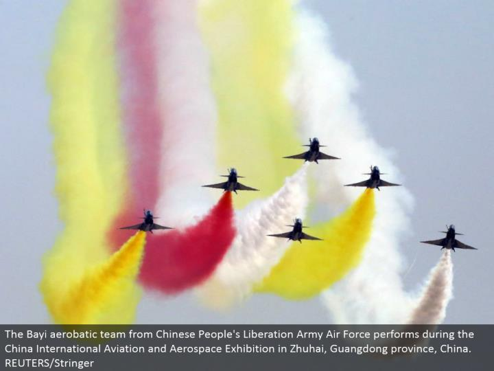 The Bayi aerobatic group from Chinese People's Liberation Army Air Force performs amid the China International Aviation and Aerospace Exhibition in Zhuhai, Guangdong territory, China. REUTERS/Stringer