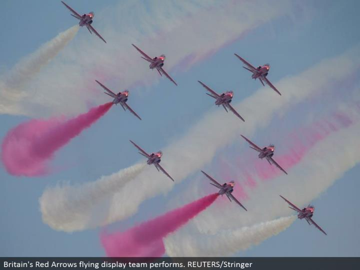Britain's Red Arrows flying showcase group performs. REUTERS/Stringer