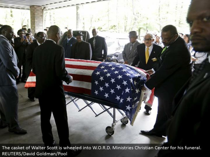 The box of Walter Scott is wheeled into W.O.R.D. Administrations Christian Center for his entombment benefit. REUTERS/David Goldman/Pool