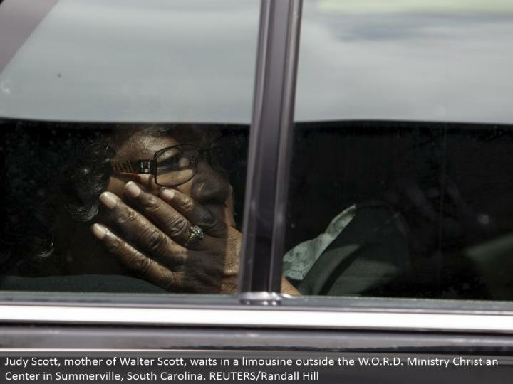 Judy Scott, mother of Walter Scott, holds up in a limousine outside the W.O.R.D. Benefit Christian Center in Summerville, South Carolina. REUTERS/Randall Hill