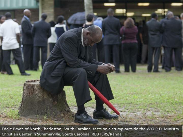 Eddie Bryan of North Charleston, South Carolina, lays on a stump outside the W.O.R.D. Benefit Christian Center in Summerville, South Carolina. REUTERS/Randall Hill