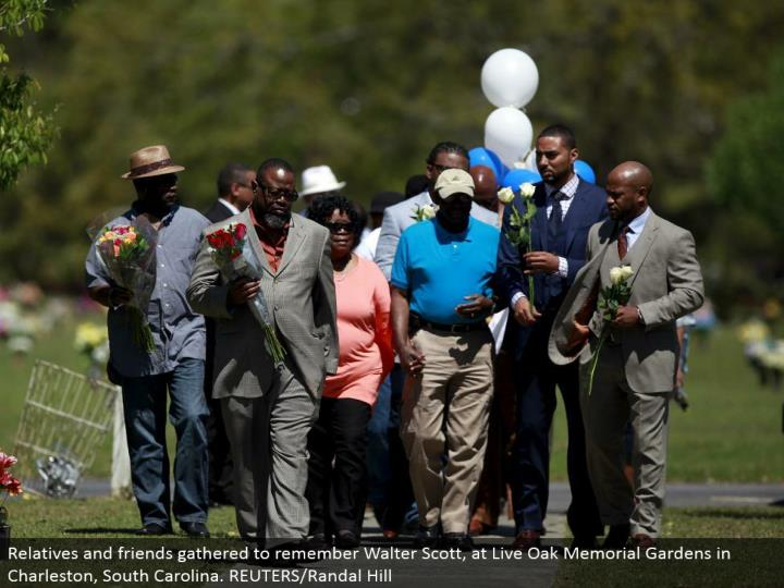 Relatives and sidekicks collected to review Walter Scott, at Live Oak Memorial Gardens in Charleston, South Carolina. REUTERS/Randal Hill